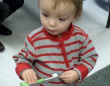 Little Boy Holding Brush in the Hand
